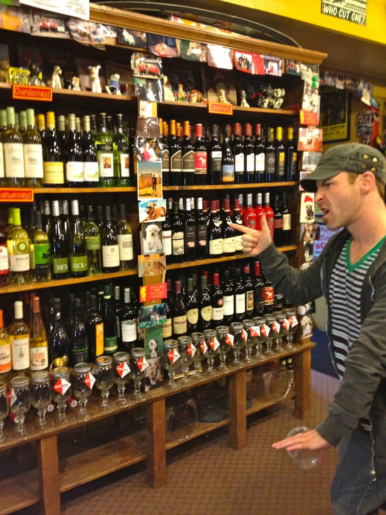 Scott looking at merchandise at Yellow Dog Eats