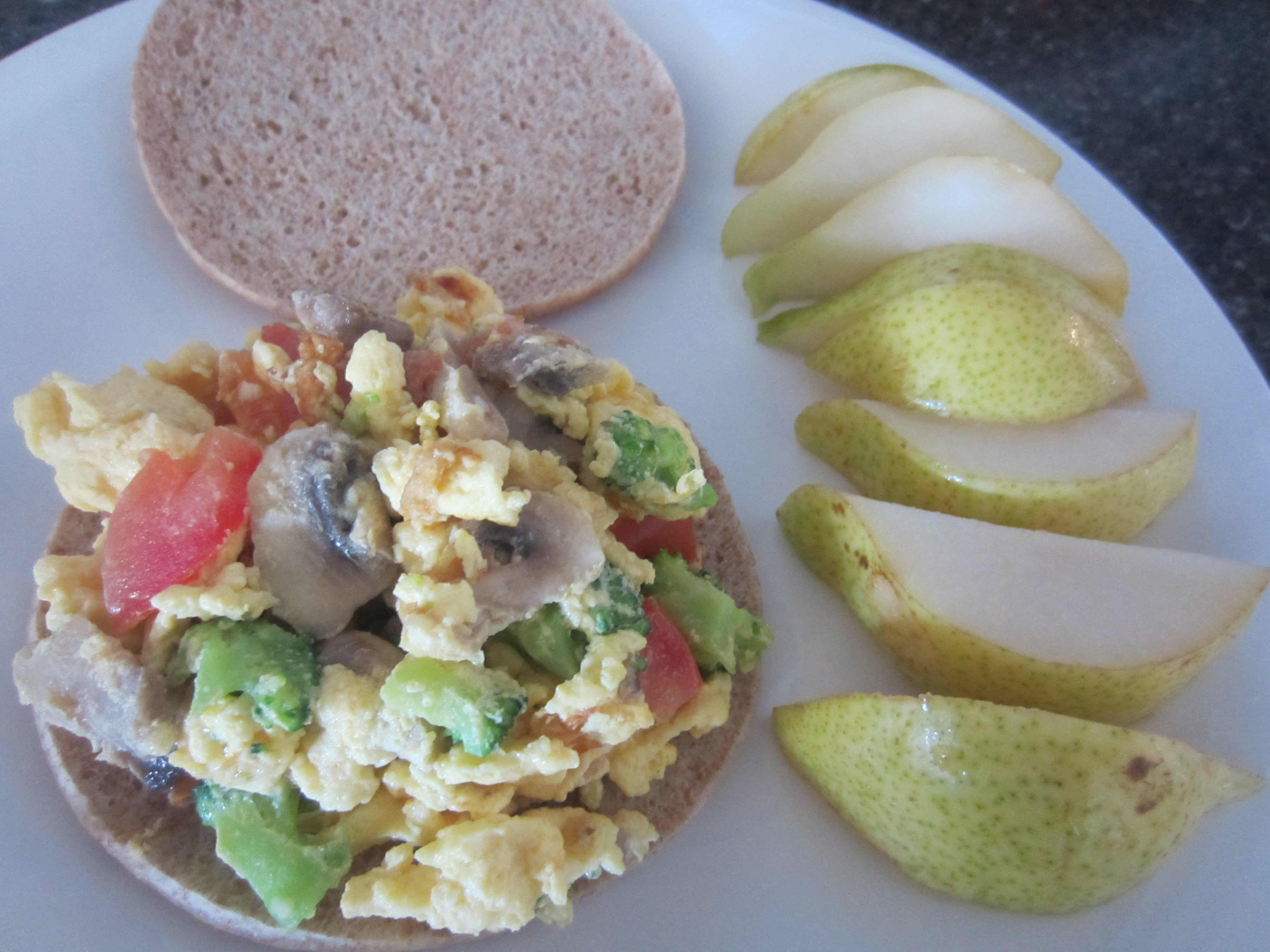 Scrambled eggs and veggie sandwich