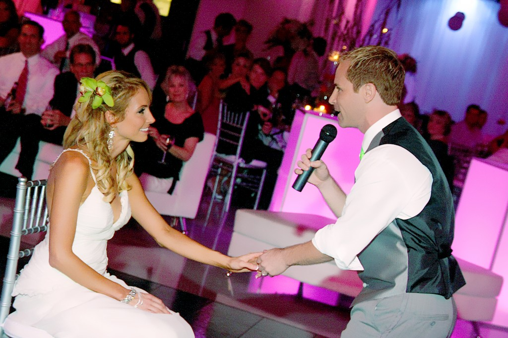 Groom sings to bride at wedding reception