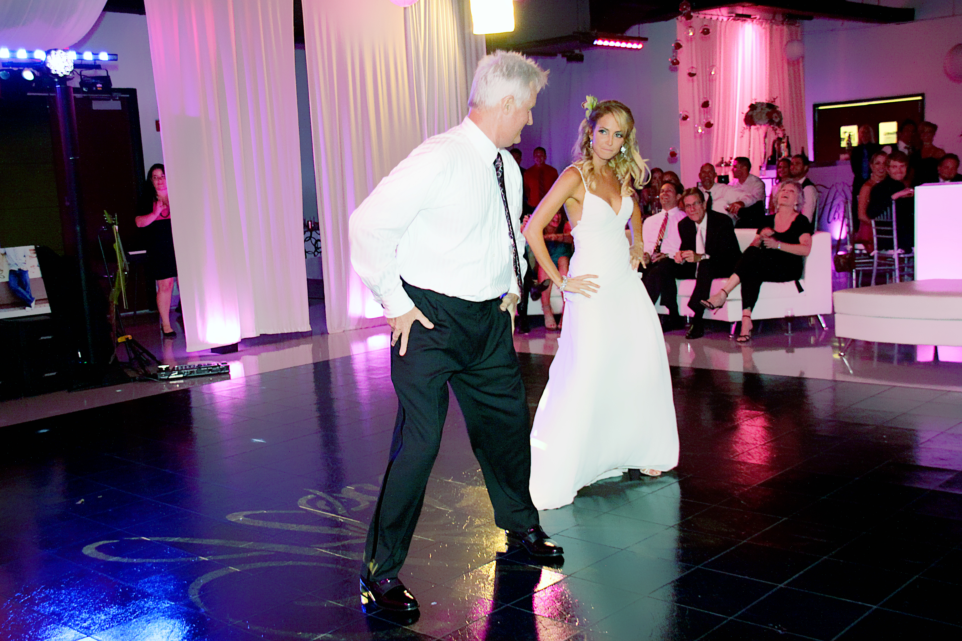 Funny father daughter dance at wedding reception
