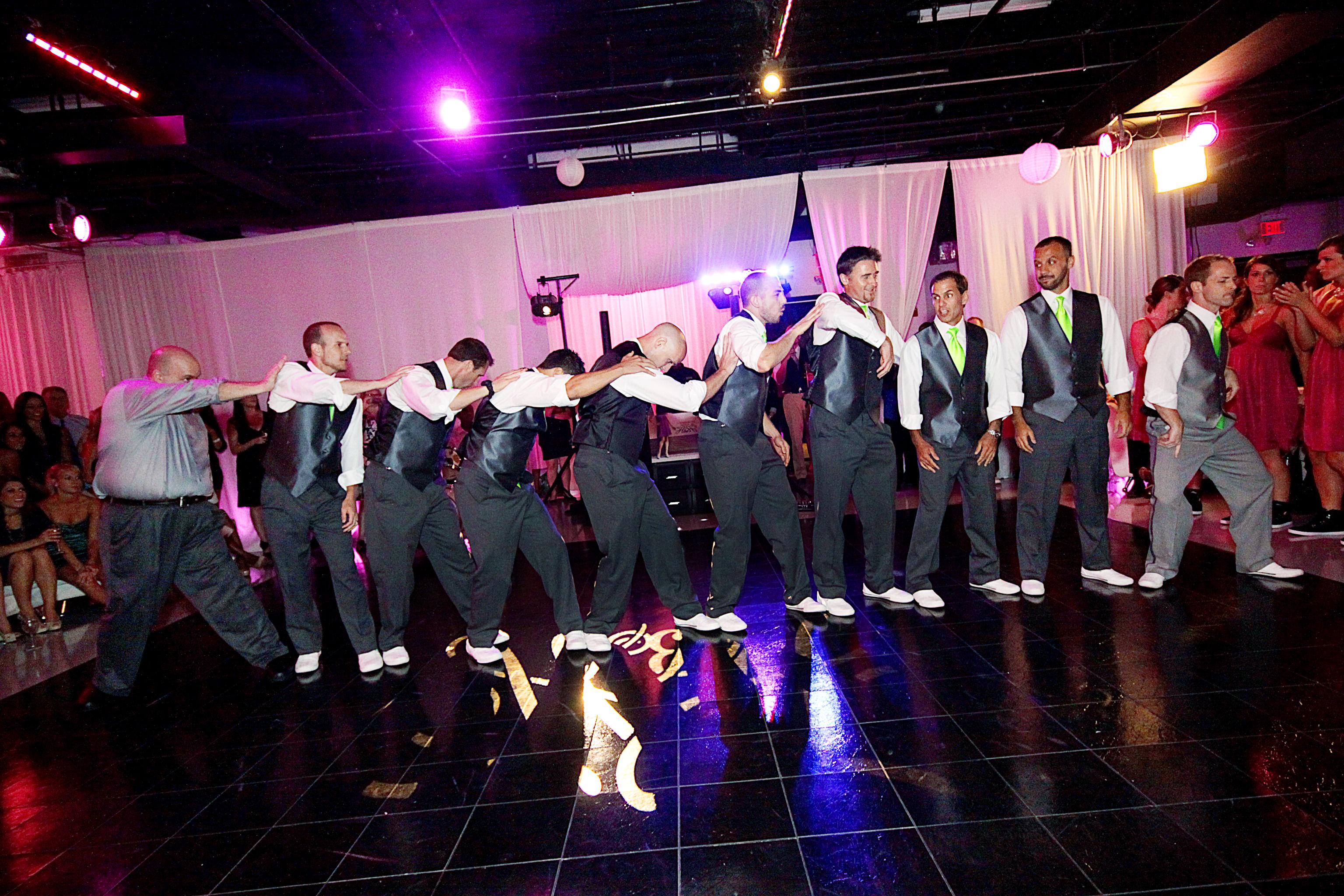 Groomsmen surprise wedding dance