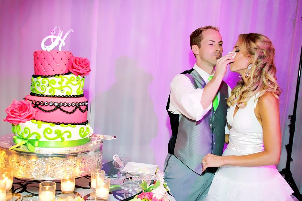 Groom smears cake on bride