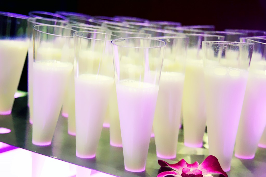 Milk shooter for cookies at wedding reception