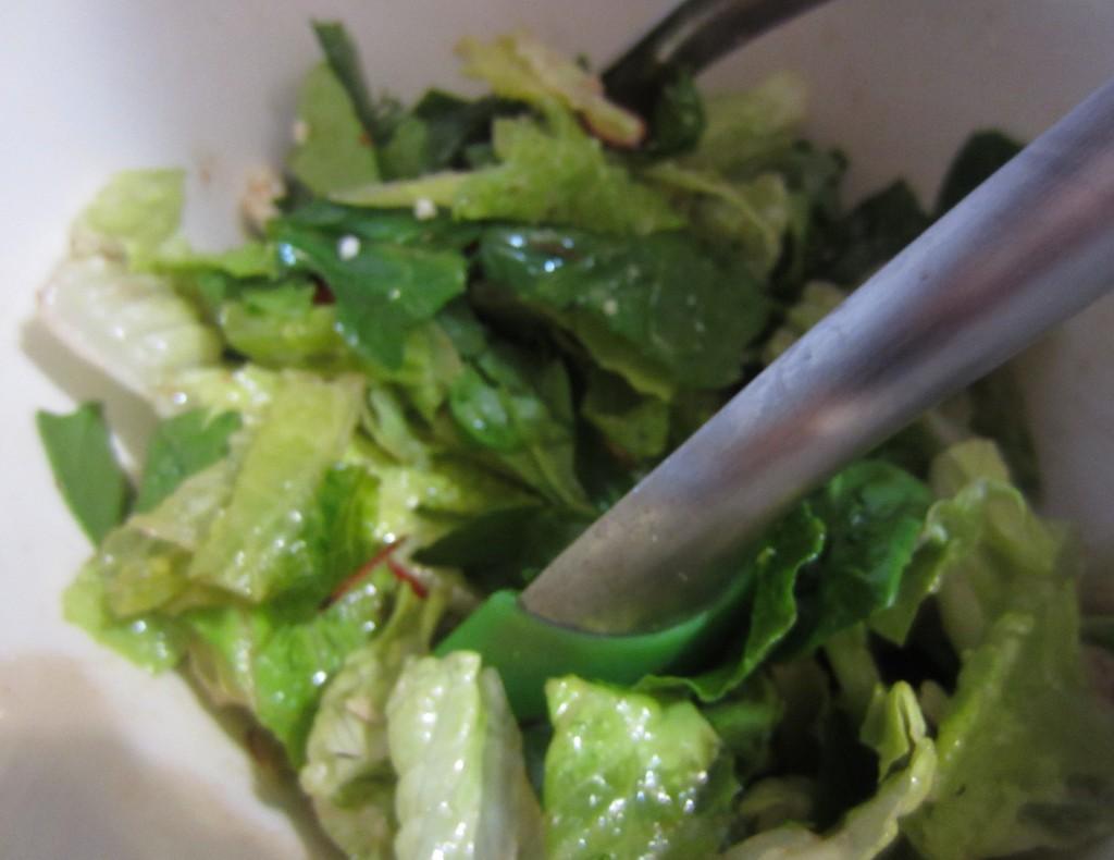 Toss salad in dressing