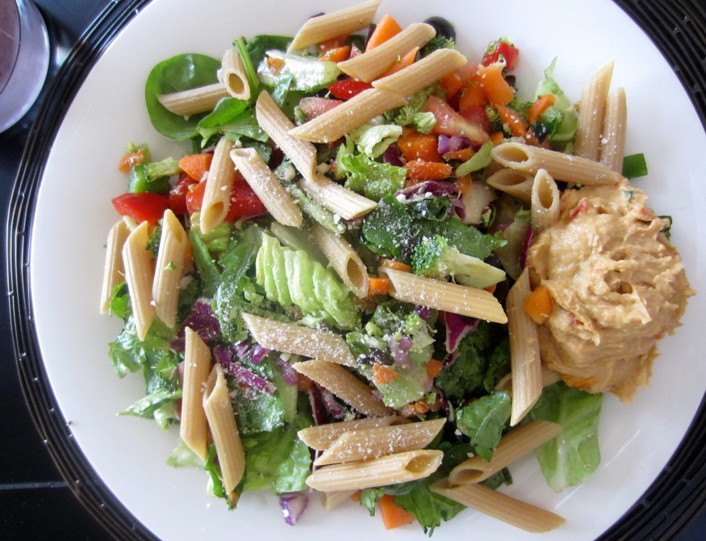 healthy salad with noodles and hummus