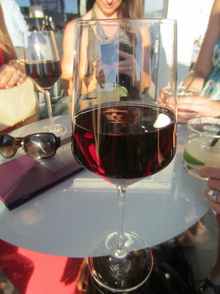 glass of wine on rooftop - The Nines Portland