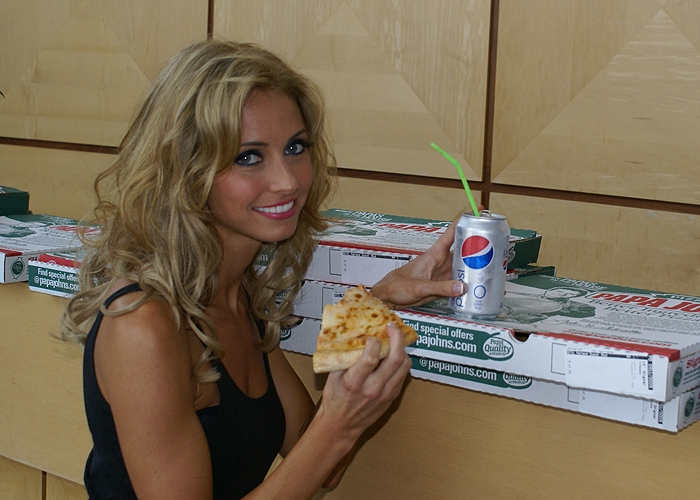 Heather eating pizza