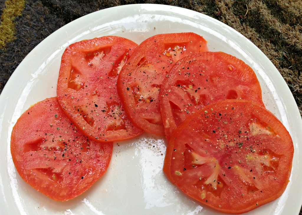 tomato slices with ground pepper