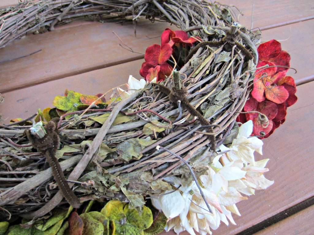 attaching flowers to wreath