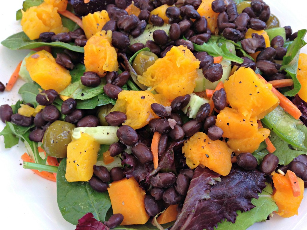 butternut squash and black beans on salad