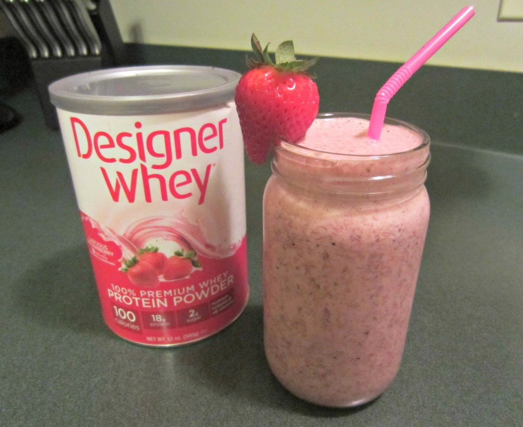 Designer Whey Strawberry Protein Powder and smoothie