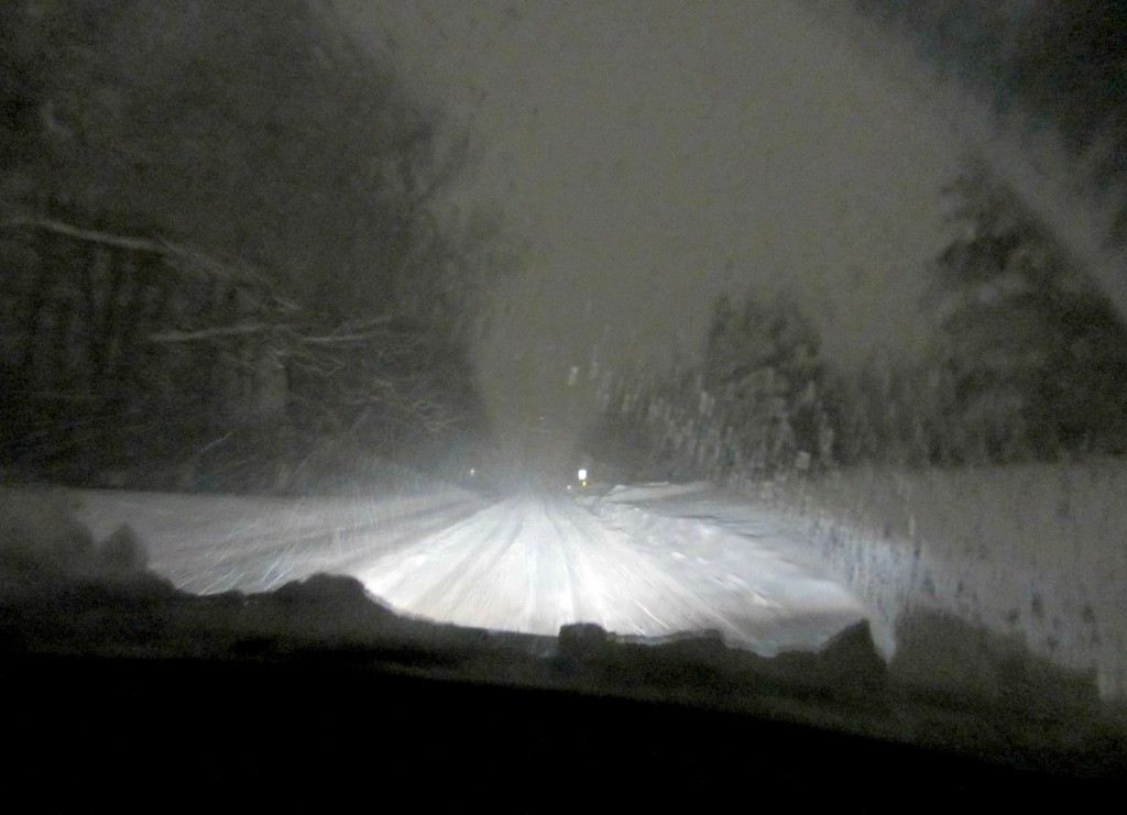 driving in snow at nigttime