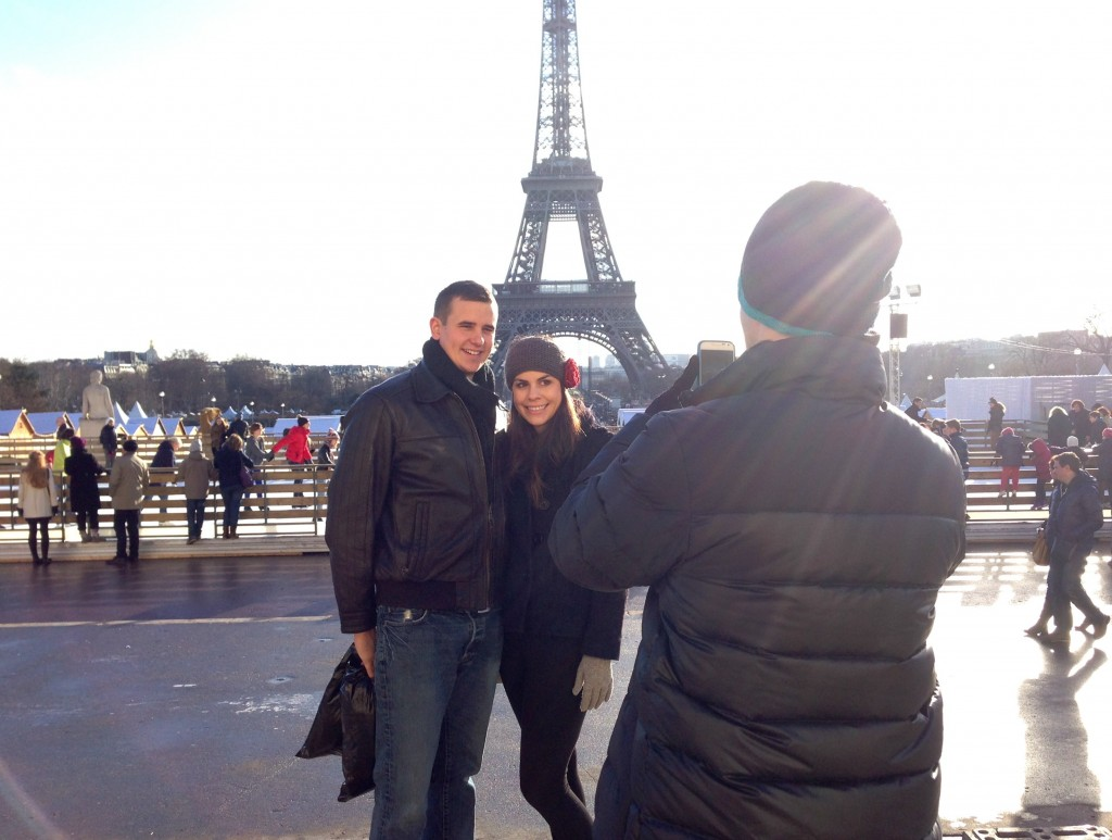 taking pictures in front of eiffel tower