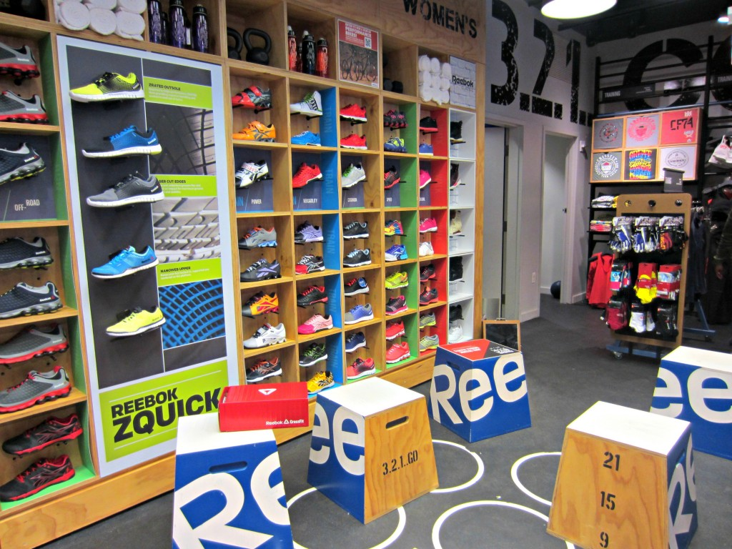 Reebok FitHub sneaker wall and boxes