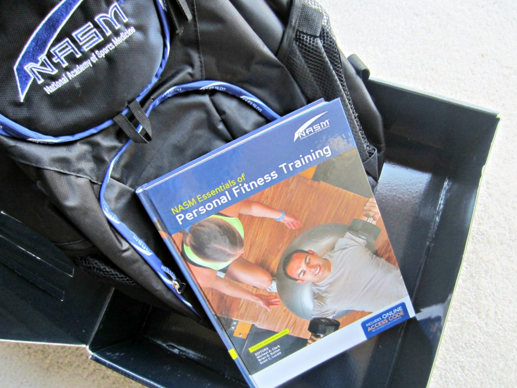 NASM textbook and backpack