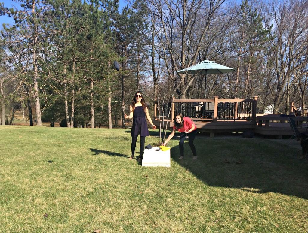 playing cornhole in the backyard