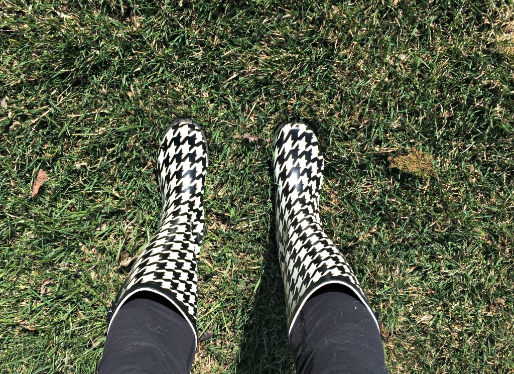 rain boots in grass
