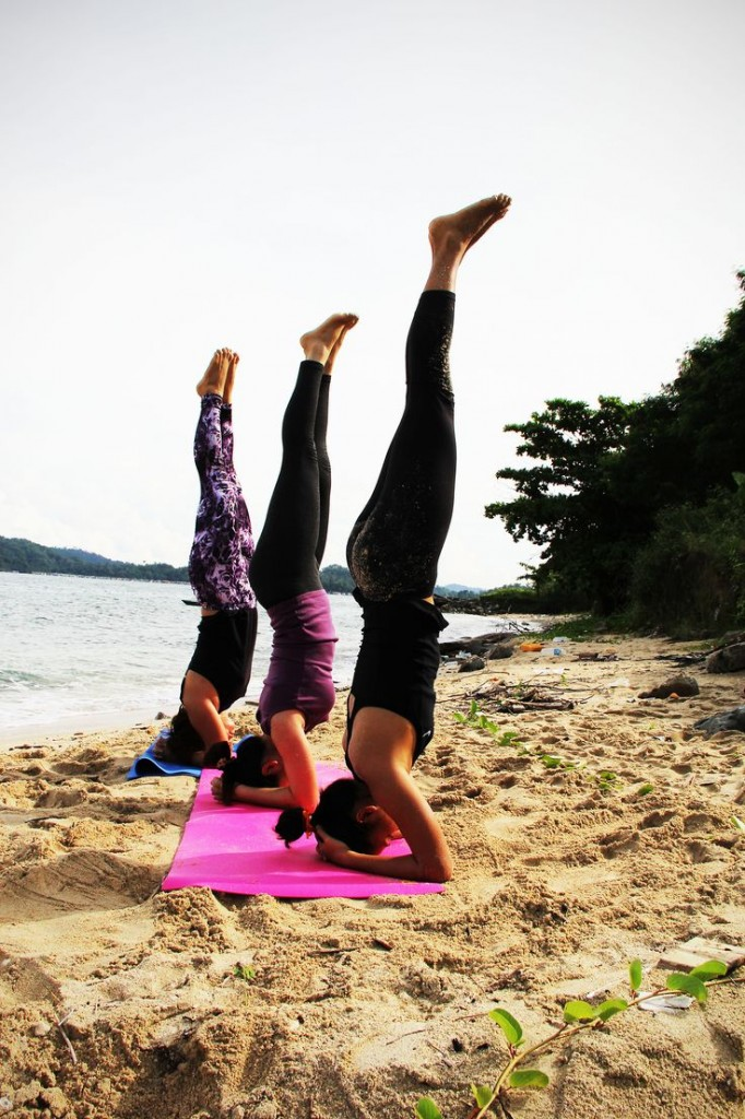 yoga headstand on the beach