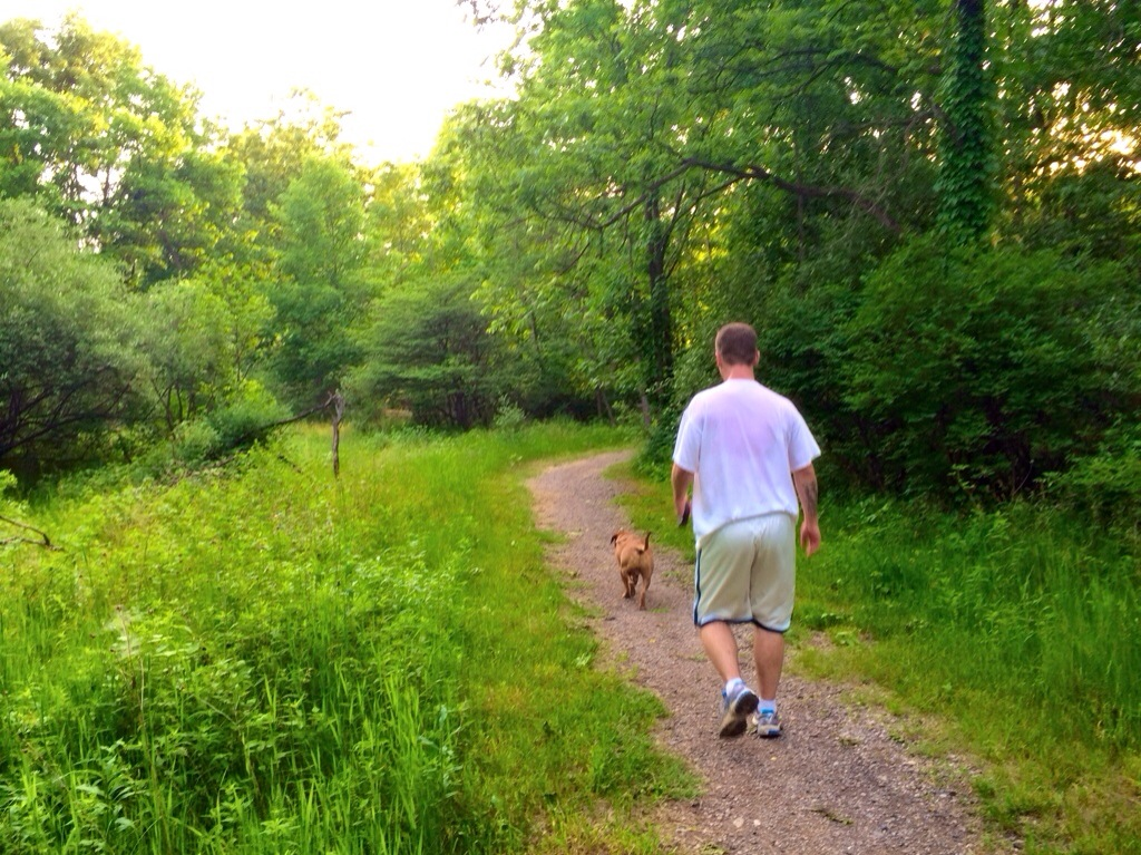 scott and roadie running the trails