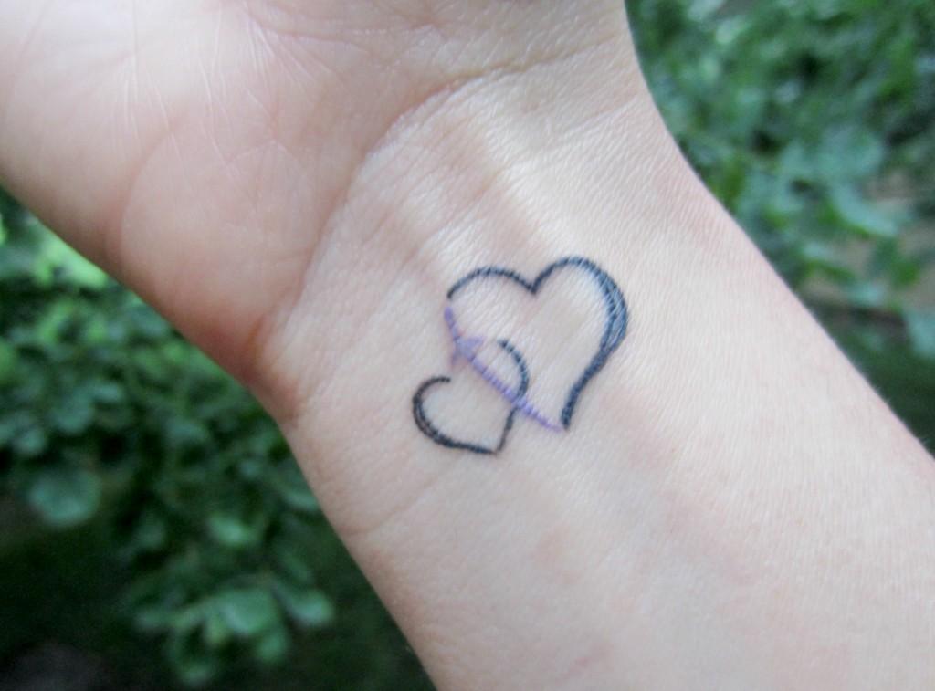 heart and cross wrist tattoo housewife glamour
