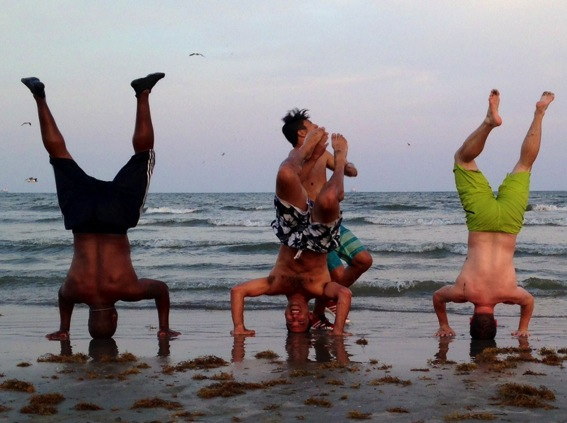 Boys being crazy on the beach jpg