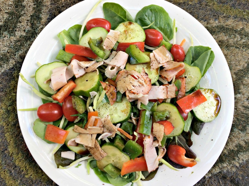 moster salad with veggies and turkey