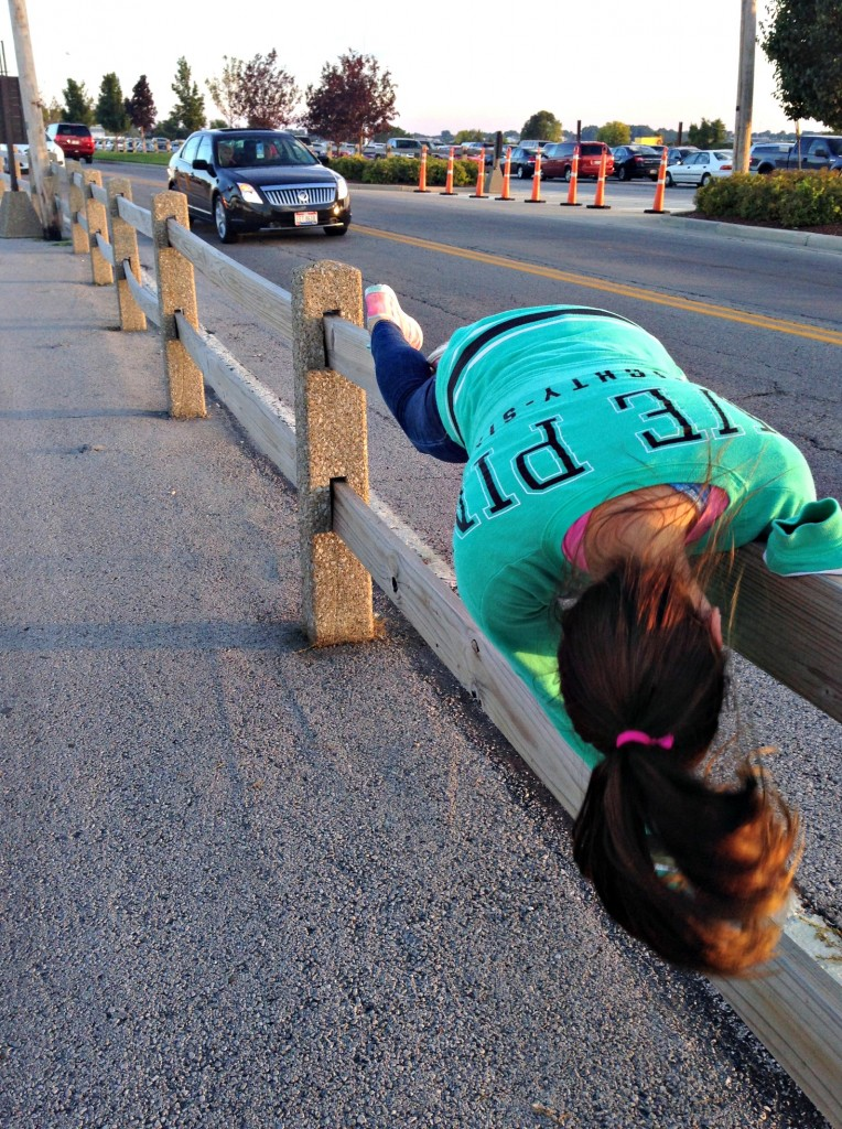 alex planking on fence