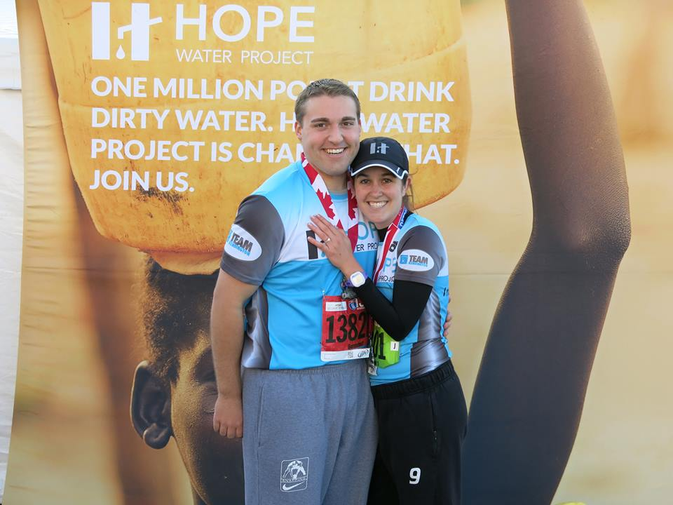 kelly and brian engaged at finish line