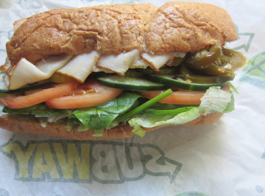 subway turkey with veggies and cheese on wheat