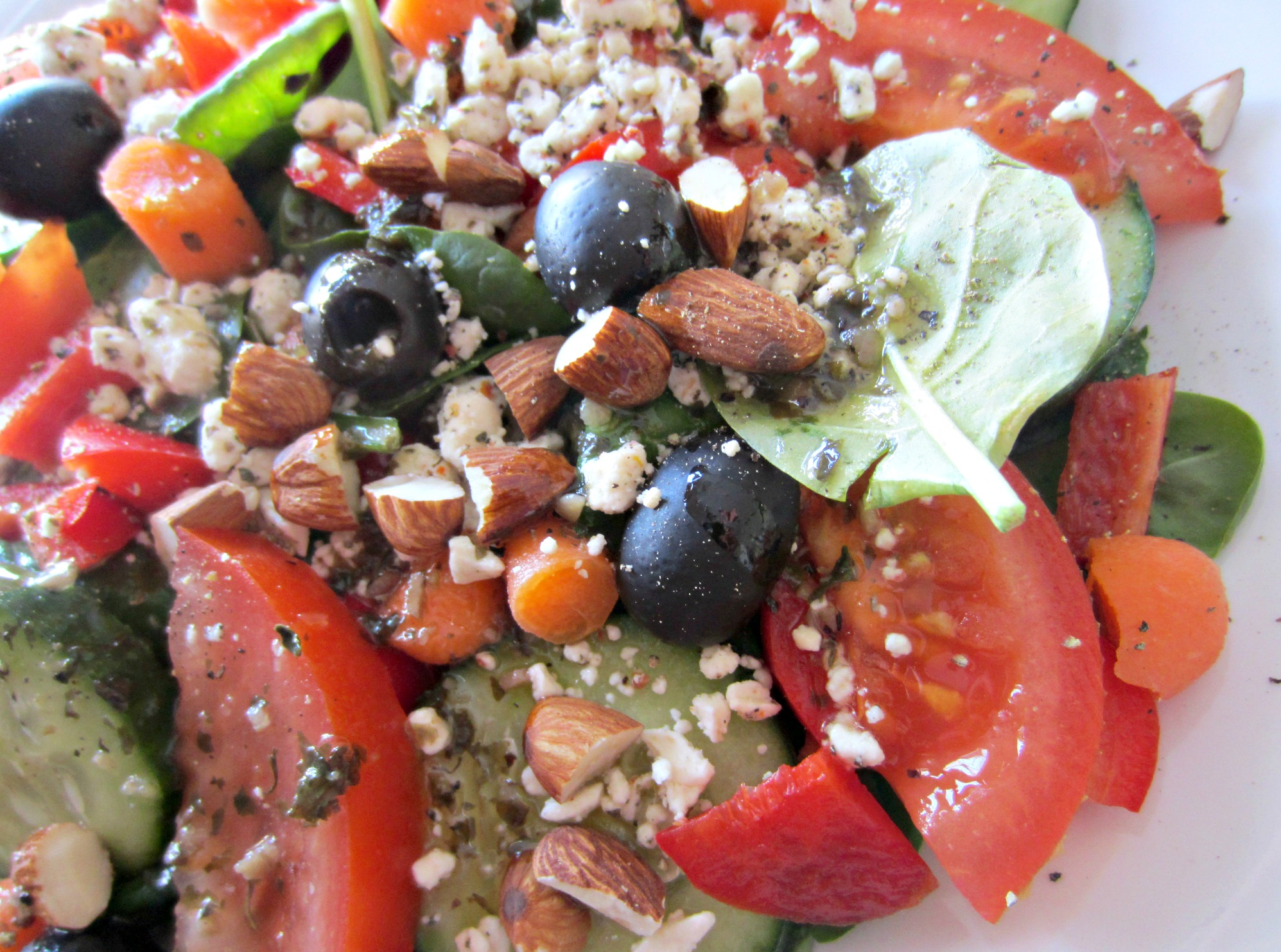 veggie loaded salad with almonds and feta cheese