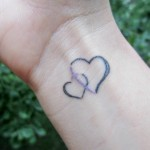 heart and cross wrist tattoo housewife glamour