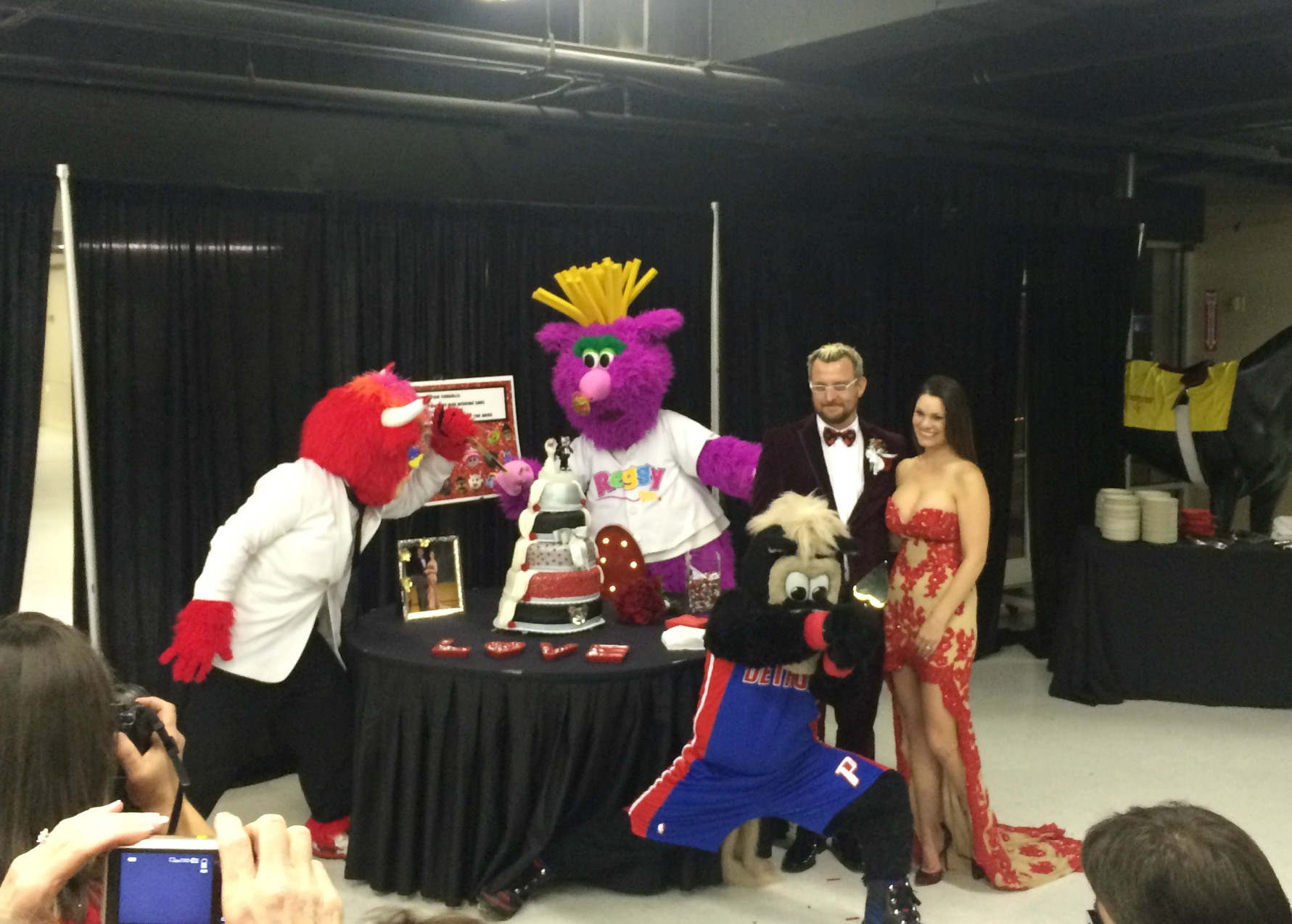 mascots with bride and groom