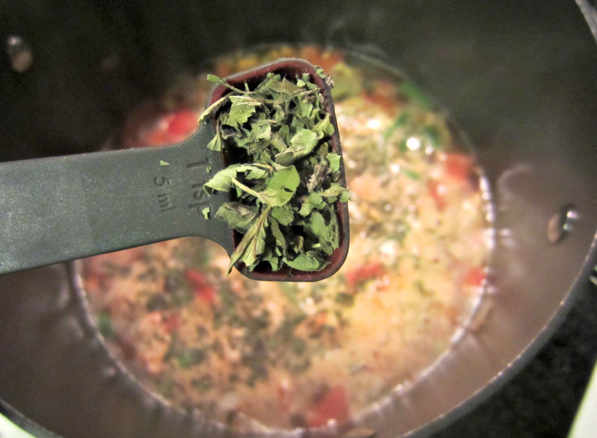 adding seasonings for soup