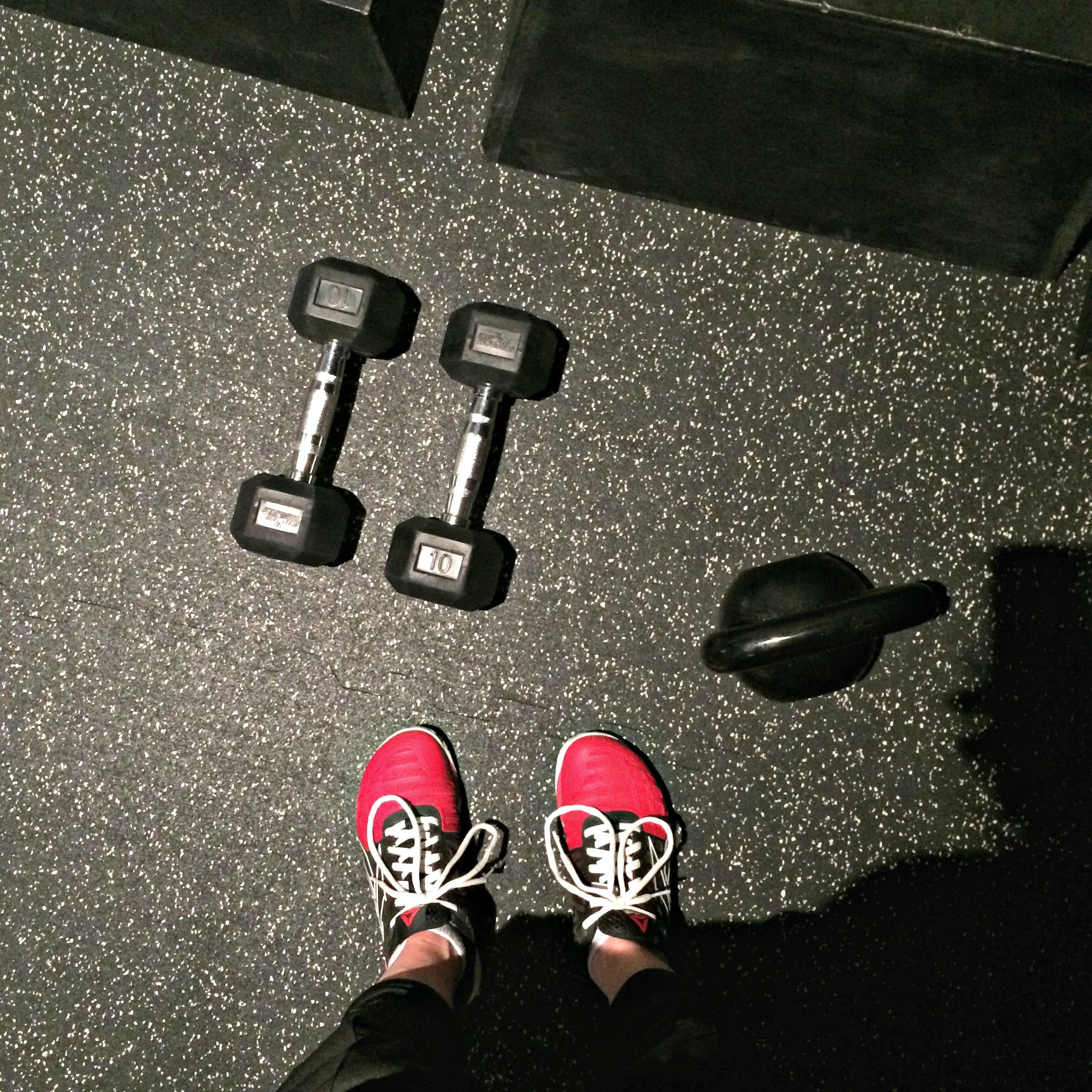 gym workout with dumbbells kettlebells and boxes