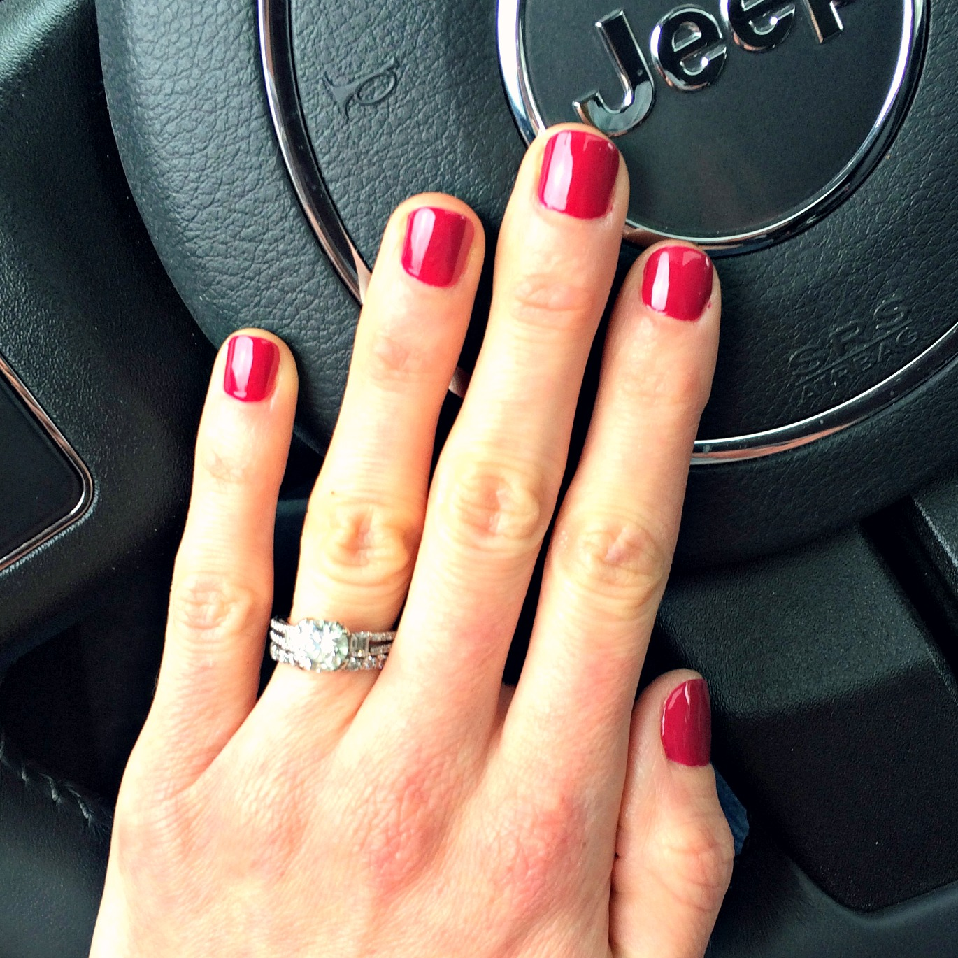 manicure with OPI miami beet polish