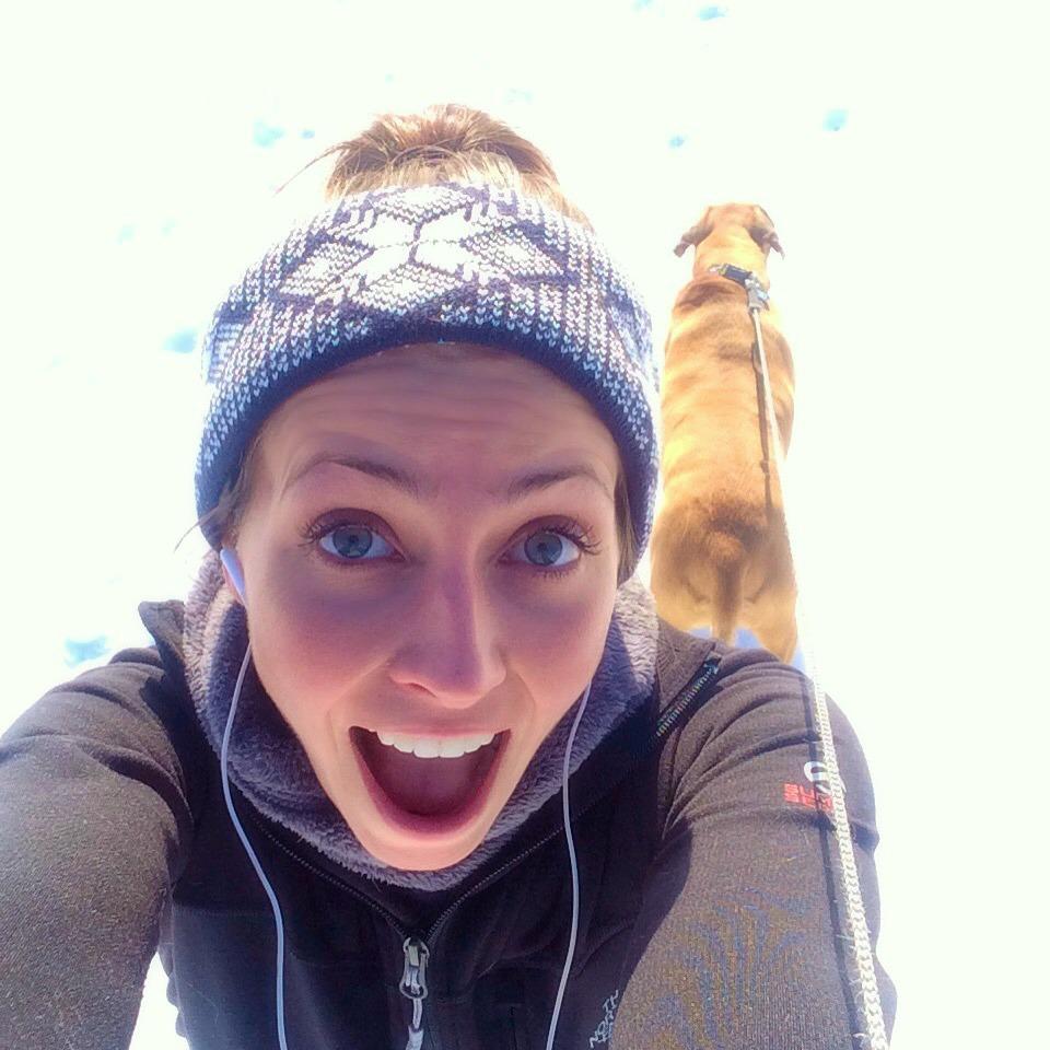 running in the snow with roadie selfie