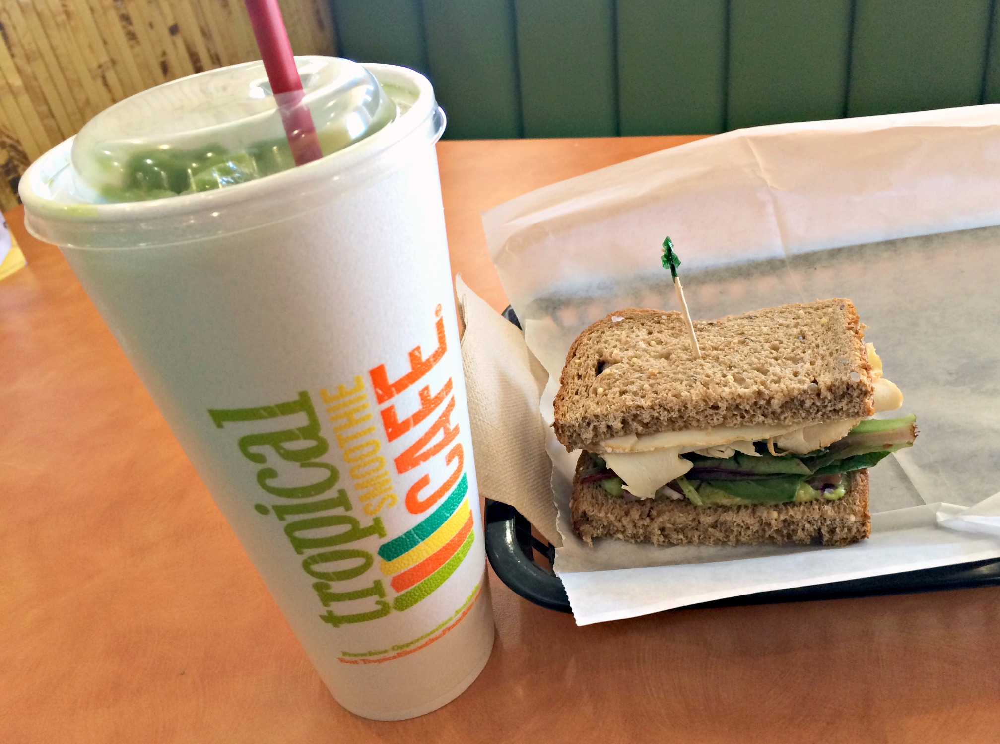 tropical smoothie avocolada smoothie and turkey guacamole sandwich