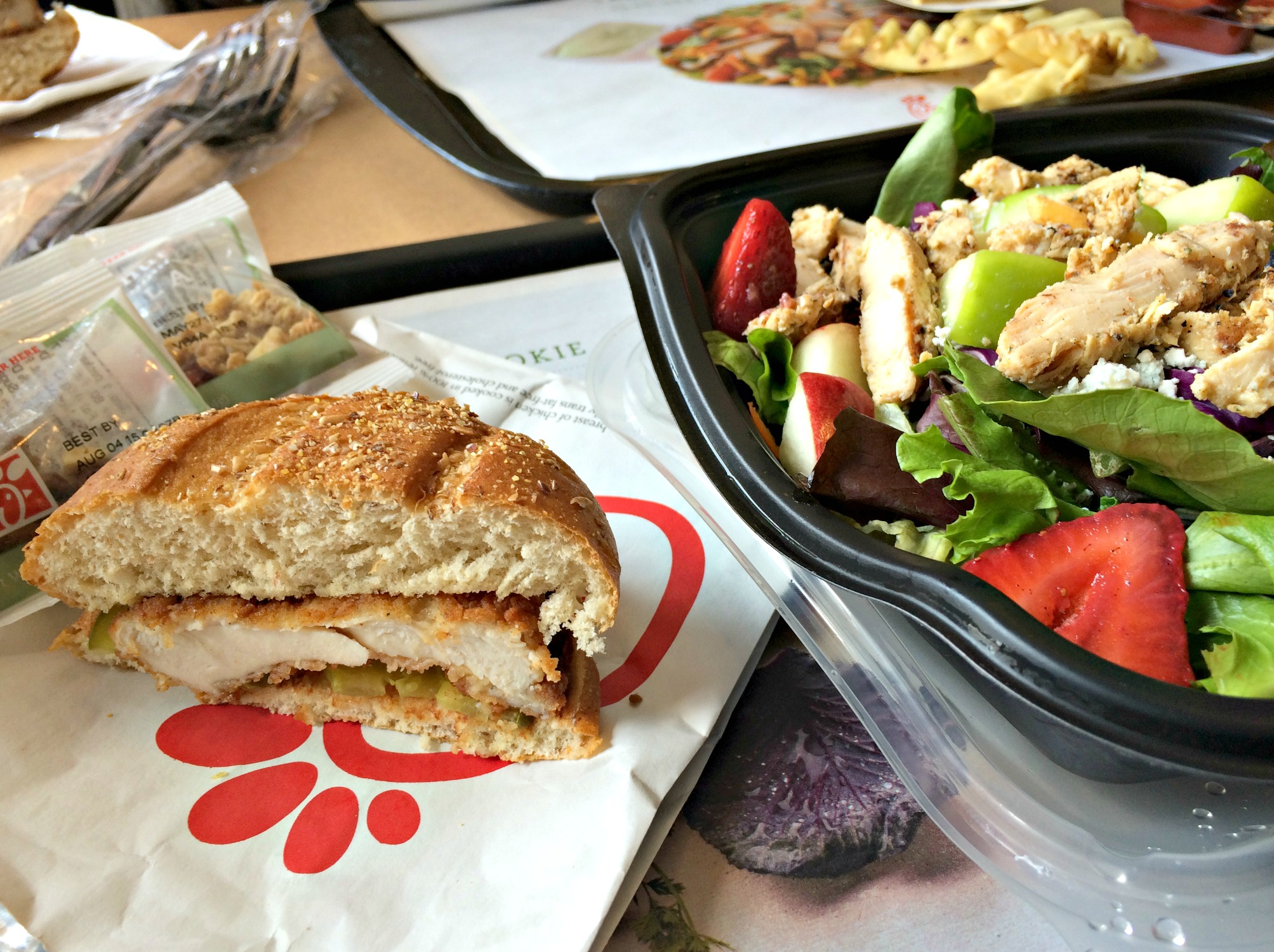 Chick-fil-A sandwich with fruit on salad and fries