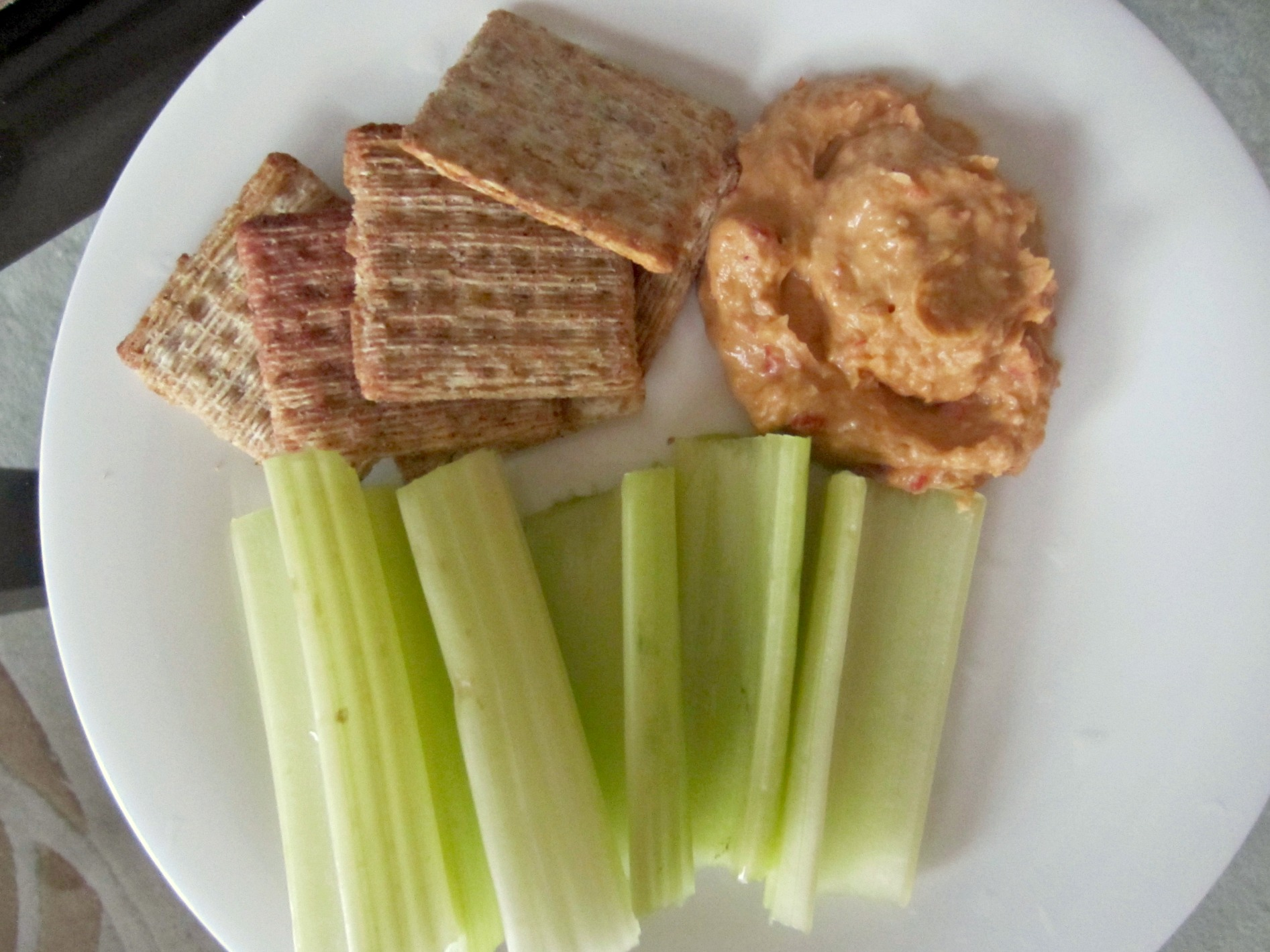 celery and crackers with hummus