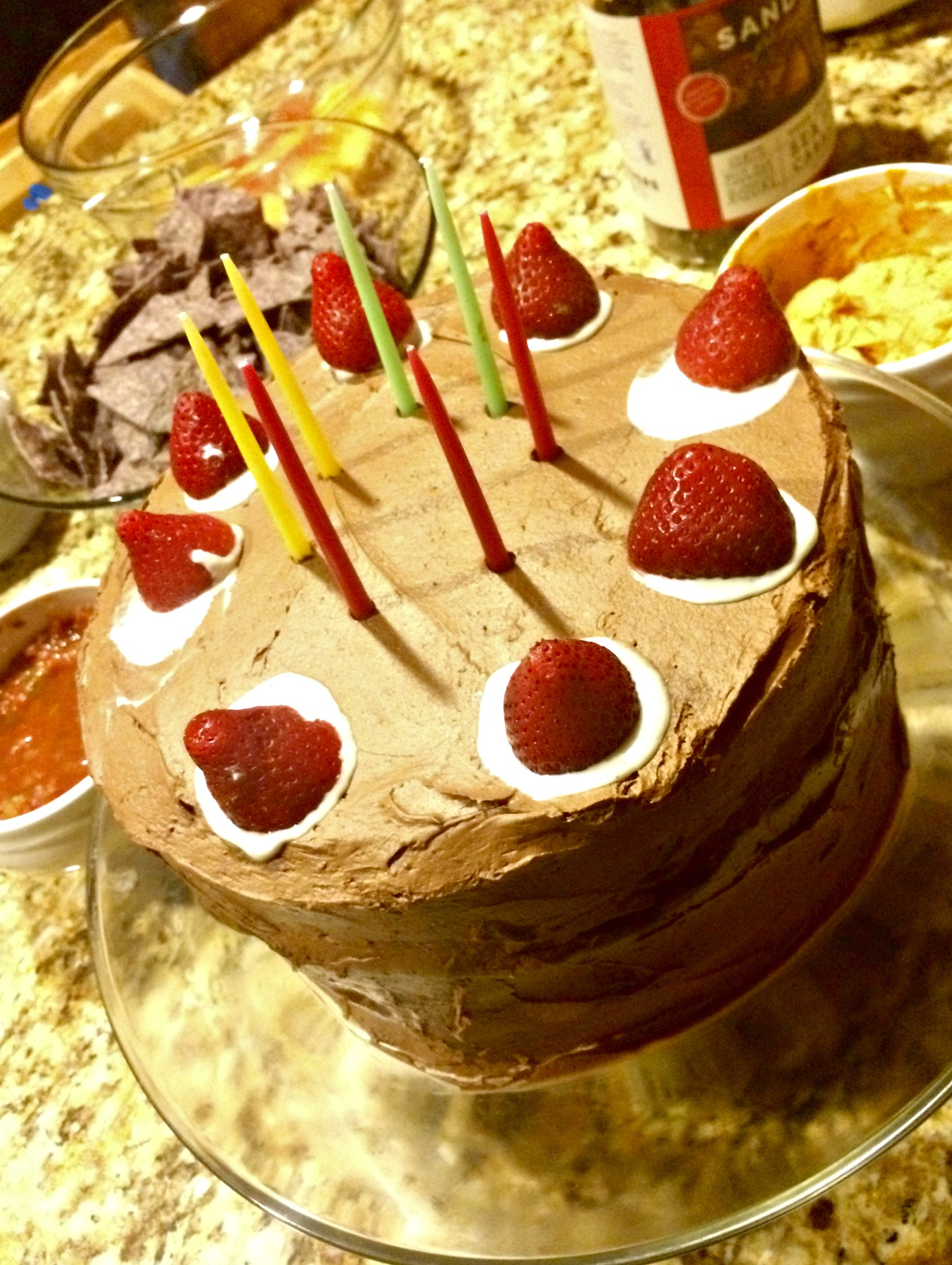 chocolate cake topped in strawberries
