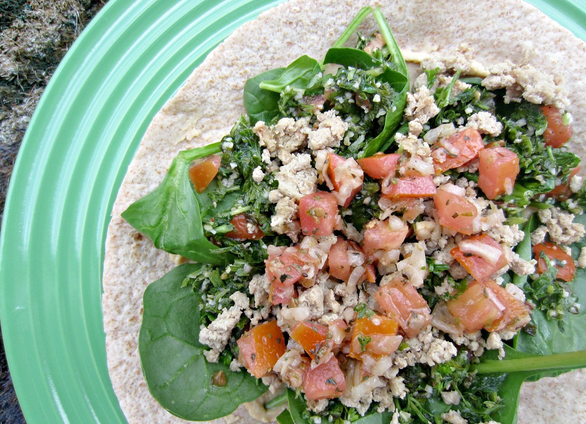 healthy lunch wrap with spinach, tabboleh, tomato and ground turkey