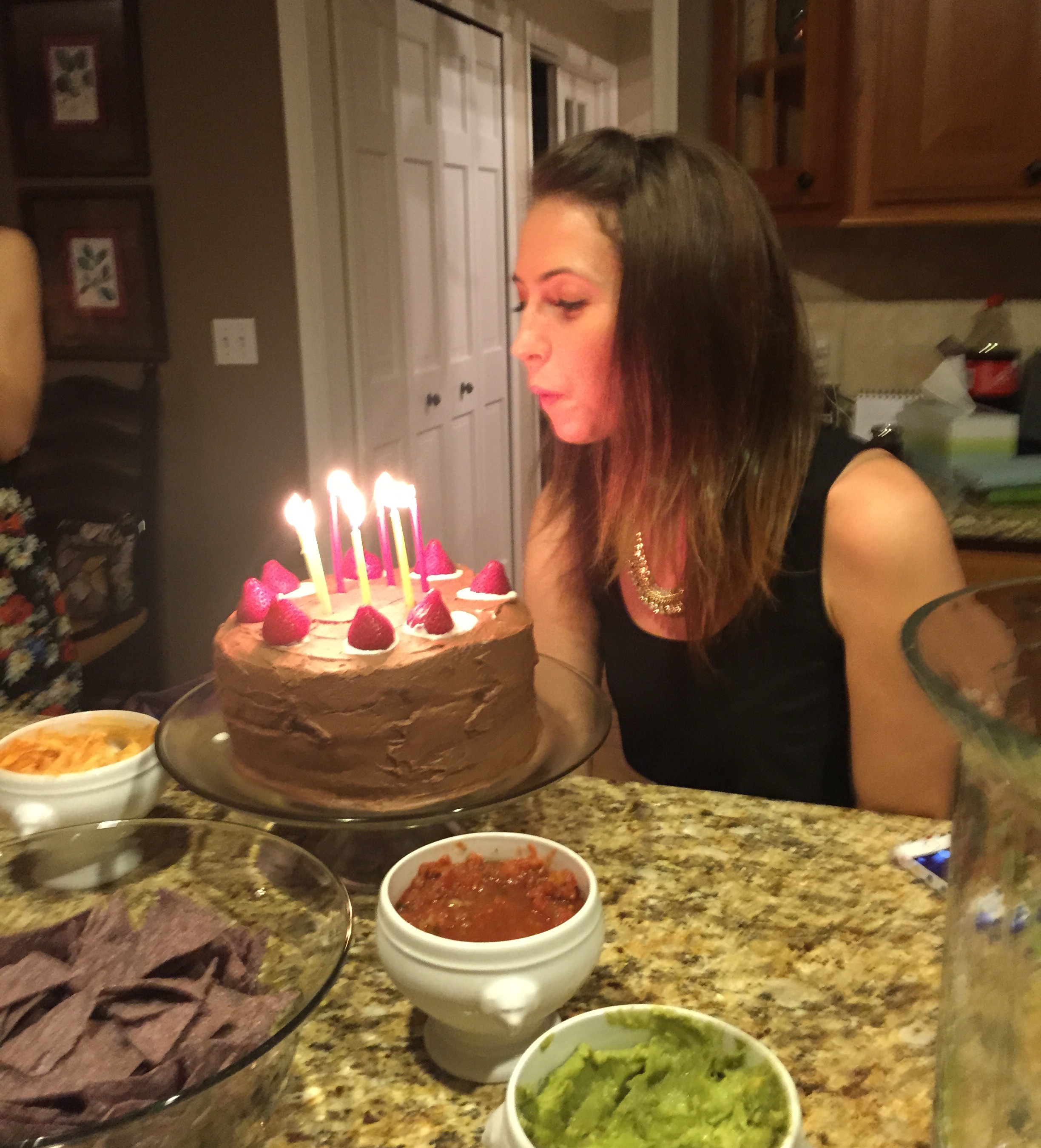 heather blowing out candles