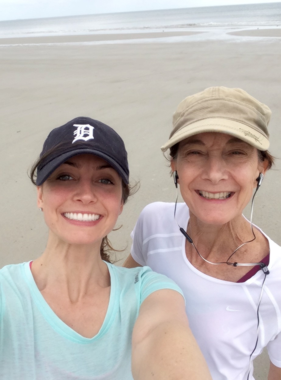 running on the beach with mom