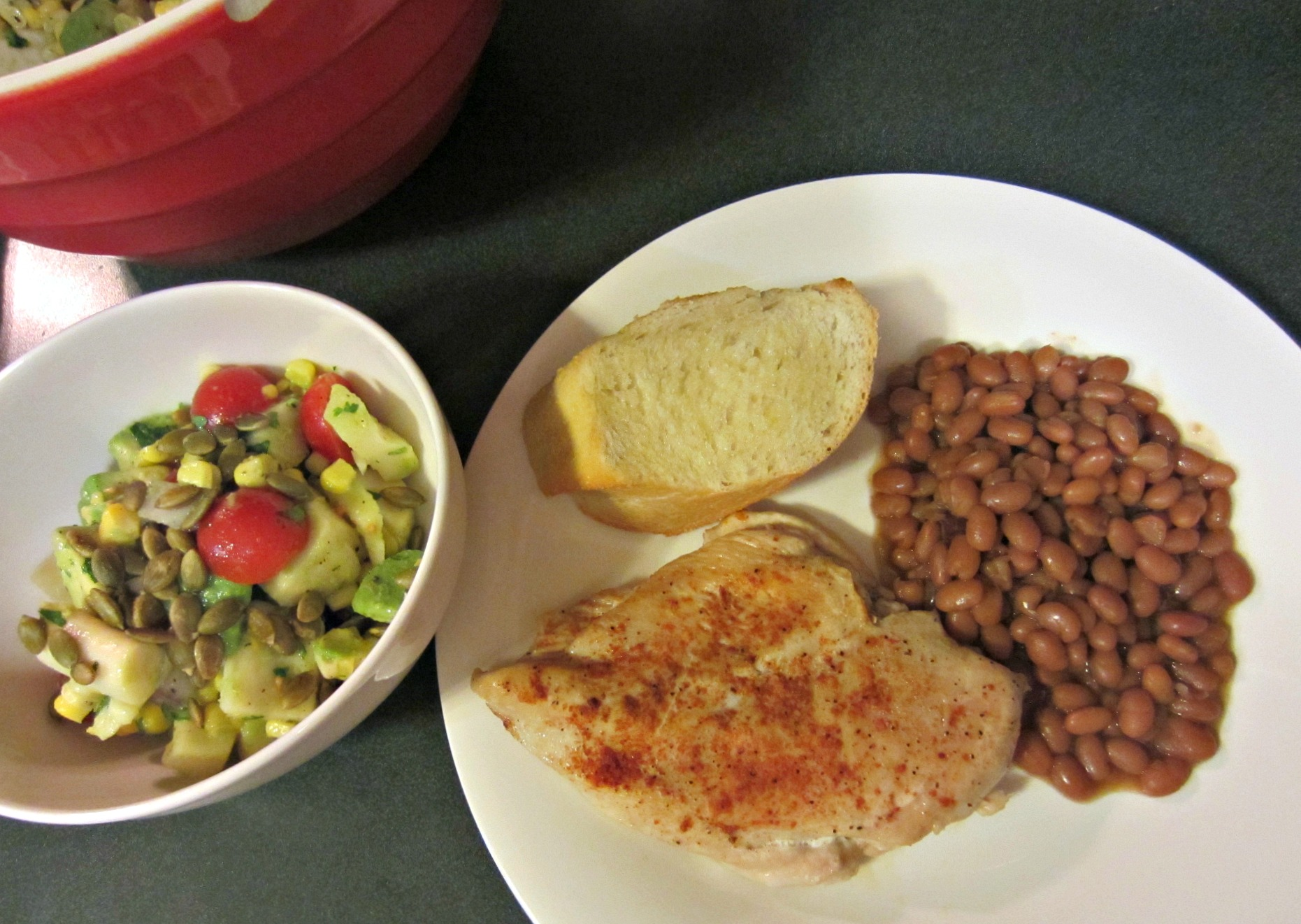 chicken dinner with beans and healthy avocado salad