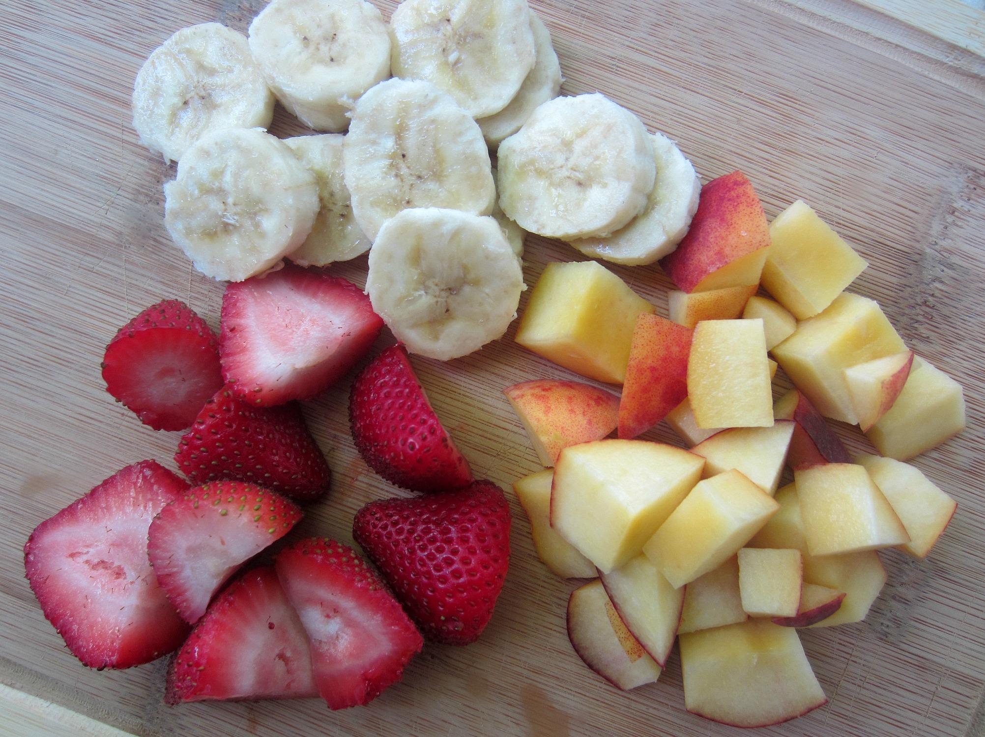 fresh fruit banana strawberries and nectarine