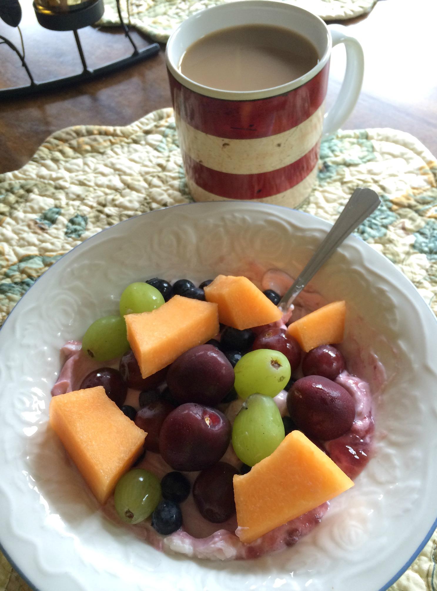 coffee with fruit and yogurt bowl