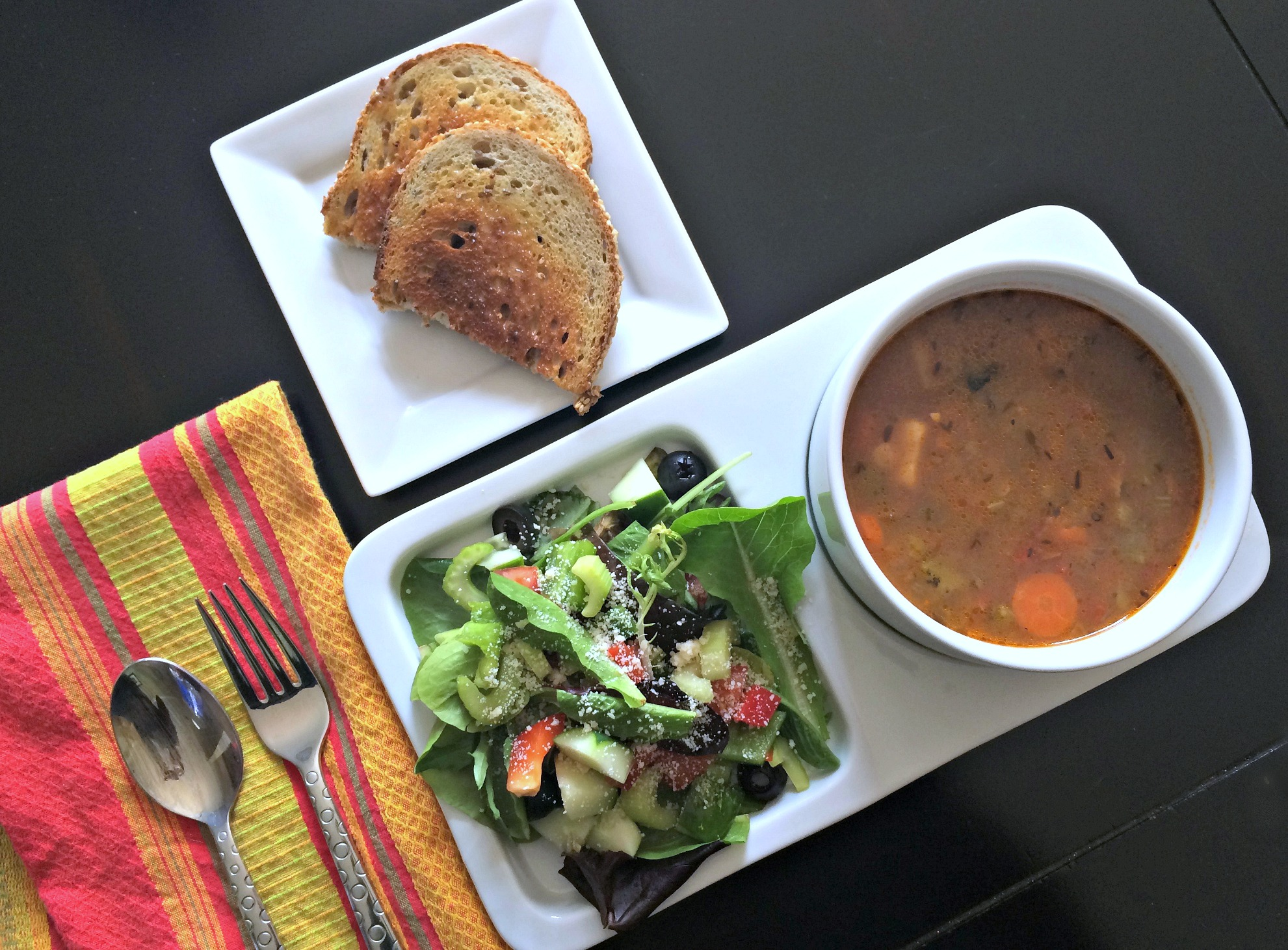 healthy lunch salad with vegetable soup and wheat toast