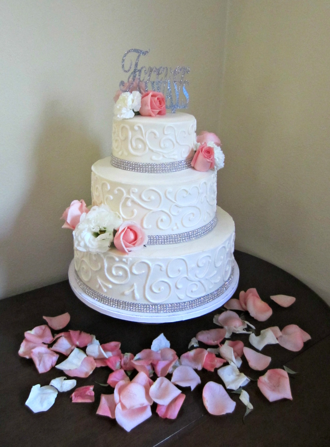 wedding cake with flowers and crystals