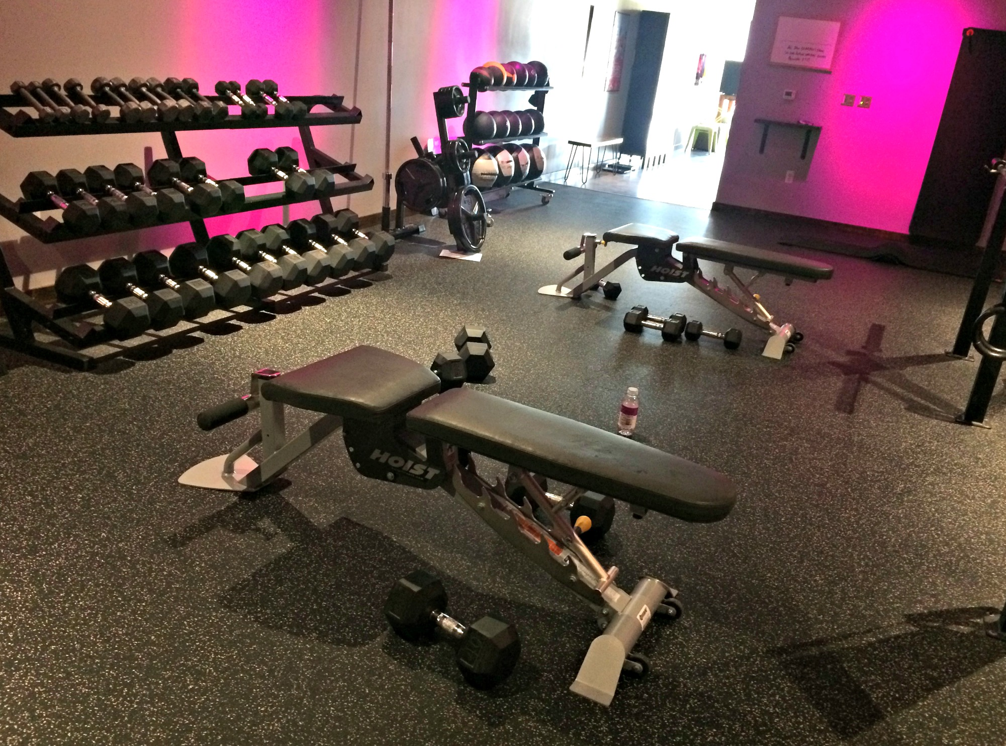 weight room with dumbbells