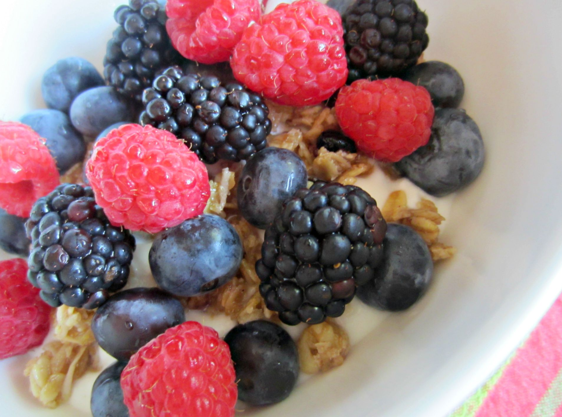 berries over yogurt and soft granola